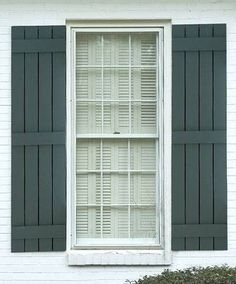 One of the popular style of wooden shutters is the board and batten style of shu. - One of the popular style of wooden shutters is the board and batten style of shutter. This type of shutters brings back an old style feel a. Types Of Shutters, Diy Shutters, Wooden Shutters, Repurposed Shutters, Exterior Shutters, Bedroom Shutters, Kitchen Shutters, Plastic Shutters, Green Shutters