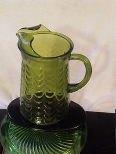 Vintage Pitcher Green Depression Glass ,Green Whitehall Pitcher Mid Century Kitchen, Heavy Duty Tea Pitcher, Scalloped Half-Circle Design #etsyseller @DWedgeCreations​ dwedgecreations.etsy.com #dwedgecreations #DepressionGlass	#GreenPitcher	#GreenglassPitcher #VintagePitcher	#WhitehallPitcher #GreenGlass #Whitehall #GreenGlassPitcher	#MidCenturyPitcher #MidCenturyGlass #MidCenturyKitchen #TeaPitcher	#VintageTeaPitcher #beautiful #fashion #etsybestseller #etsyshop