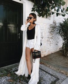 Light white kimono, white shorts and black top outfit. Wear an updo for an elegant touch. Perfect minimal summer outfit