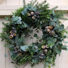 Foliage Christmas Wreath with poppy seed heads, sea holly and herbs. Foliage Christmas Wreath with poppy seed heads, sea holly and herbs. Christmas Door Wreaths, Christmas Flowers, Rustic Christmas, Flower Head Wreaths, Corona Floral, Sea Holly, Wedding Wreaths, Wedding Flowers, How To Make Wreaths