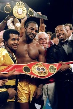 With Evander Holyfield and M.C. Hammer after Holyfield defeated Riddick Bowe in 12 rounds on Nov. 6, 1993 in Las Vegas - Classic Photos of Emanuel Steward - Photos - SI.com