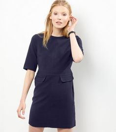 Add this short sleeve dress into your evening out wardrobe this season. Try complementing with boots to finish the look.- Rounded neckline- Simple short sleeves- Double flap pocket detail- Zip back fastening- Casual fit that is true to size- Dress length: 33