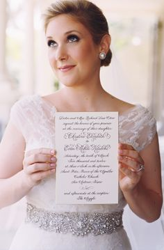 Christina Otero holding formal wedding invitation! www.jwilkinsonco.com #photography #film #wedding #invitations #theargyle