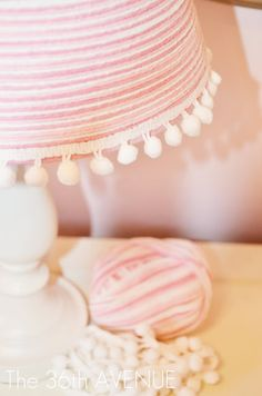 Yarn lamp! I like this idea, but the color(s) would be different for me. Cute for a little girl's room though!