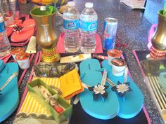 """Bachelorette swag bag. Customized pimp cups and flip flops, water, red bull, coffee pods, chapstick, sunglasses, pen and notepad, and sunsreen. All in navy blue and pink """"Amor"""" bag from old navy."""