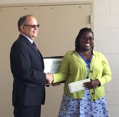 Kenya Russell with Saint Francis Hospital's John Quinlavin