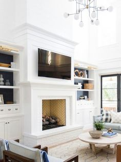 Note the tall mantle stops short of the ceiling height. Also, raised hearth. Log Burner Living Room, Living Room Decor Fireplace, Basement Fireplace, Build A Fireplace, Tall Fireplace, Fireplace Hearth, Home Fireplace, Modern Fireplace, Fireplace Surrounds