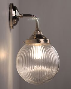 CONTEMPORARY WALL LIGHT WITH GOODRICH PRISMATIC GLOBE bathroom light available in antique brass fritz fryer