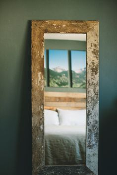 Reclaimed white panelling wood turned into awesome mirror by www.MontaneDesigns.com