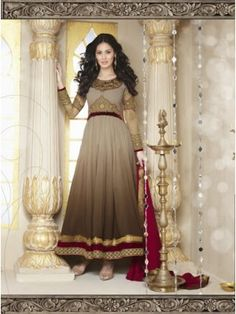 Brown Georgette Designer Anarkali Suit Collection at skbmart.com. BUY PARTY WEAR ANARKALI CHURIDAR SUITS, Women's Salwar kameez - Indian Women Salwar kameez, Anarkali Suits design.long anarkali suits collection, Brown Georgette Designer Anarkali Suit -Features heavy golden embroidery with zari, threads, patchs and stones on beautiful neckline, yoke, sleeves and maroon and golden border along with lace work. party were suit, Suits online, latest Collection for churidar Anarkali Suit