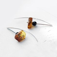 Baltic Amber and faceted onyx earrings  Dangle Earrings
