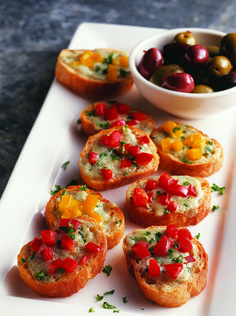 Blue Cheese Bruschetta — top toasted baguette with blue cheese, bell peppers and green onions for an easy and delicious party appetizer.
