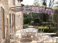 love the iron work over the terrace, Provence home of Vicki Archer