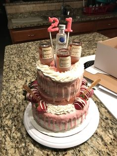 Tipsy cake: Hennessy infused cake, topped with Hennessy and Ciroc bottles