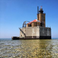 Port Austin Reef Lighthouse is located in Lake Huron, 1.25 miles from land, and 2.5 miles from the harbor in Port Austin, Michigan, photo by Mark Erickson