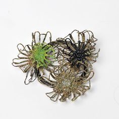 Katie Owen - brooch - plastic coated steel wire, Photography - Gina Hughes