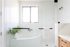 Exquisitely appointed bathroom features a large walk-in shower enclosed behind glass doors donning oil rubbed bronze pulls. Corner Tub Shower Combo, Corner Bathtub Shower, Jacuzzi Bathtub, Bathroom Tub Shower, Small Bathtub, Small Bathroom, Bathtubs, Small Corner Bath, Boho Bathroom