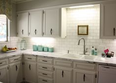 Like the cornice going across the sink with the spot lighting.