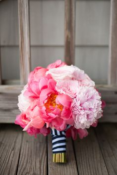 Pink peony bouquet with navy striped ribbon