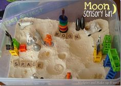 Moon sensory bin using cloud dough!  Love all the stuff she includes...would be neat to add a small pair of toy boots for making footprints!