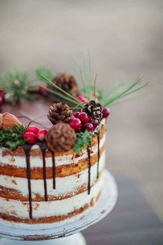 27 Naked Fall Wedding Cakes That Will Make Your Mouth Water: #24. Chocolate drip fall wedding cake with berries and pinecones