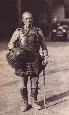 Japanese soldier wearing an antique samurai armor backwards, 1920s - 1930s.