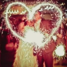 Want a simple way to add sparkle to your wedding and make your guests smile at the same time? Use wedding sparklers! {Image via Wedding Bee}