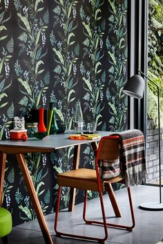 This beautiful botanical wallpaper design is an elegant design featuring a trailing pattern of various types of leaf's including ferns.