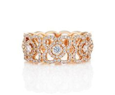 Lotus flowers in pink gold with 301 round brilliant #diamonds #ring by De Beers. #diamond