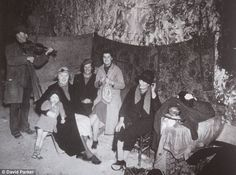 Blitz spirit: Frank the fiddler brightens up life in the labyrinth of tunnels beneath the town of Ramsgate in Kent which saved hundreds of t...
