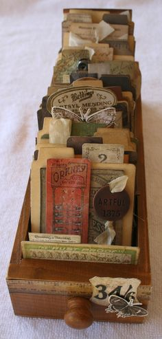 Vintage sewing notions displayed in a sewing machine drawer #vintage #sewing