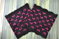 This pair of stretch lace boot cuffs is so adorable! The black lace has a cute, spunky hot pink heart pattern woven into it. Only $15 shipped from Down with Plumes!
