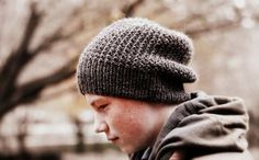 This is a simple slouch hat made for my son, and using a Broken Rib stitch. The hat is completely reversible and the crown decreases are worked seamlessly within the pattern.