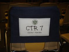 seat covers but with a clear vinyl pocket (see attached pictures) where we put a half sheet of printed cardstock with the name of each class.