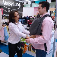 Sheena demonstrating the Trek Snuggle Carrier to Ray Quinn (X-Factor, Dancing on Ice)