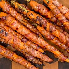 These grilled bacon wrapped carrots are an easy side dish recipe idea. Perfect as a holiday side dish or served at a BBQ. These grilled bacon wrapped carrots are an easy side dish recipe idea. Perfect as a holiday side dish or served at a BBQ. Easy Bbq Recipes, Carrot Recipes, Side Dish Recipes, Veggie Recipes, Cooking Recipes, Recipes For The Grill, Bbq Recipes Sides, Veggie Bbq, Summer Grilling Recipes