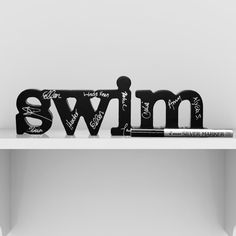 Swim SportWORDS - This carved wood decorative accessory makes a statement and is a great accent piece for home or office.