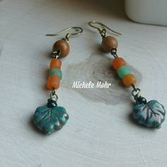 Check out this item in my Etsy shop https://www.etsy.com/listing/264437888/boho-czech-glass-leaf-and-orange-and