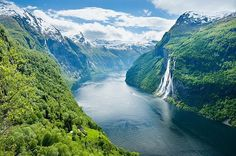 #Norway is the supermodel of #Scandinavia, a peak - and fjord - blessed country that gives its neighbours a serious case of mountain envy. This glorious shot is the glacier-carved Geirangerfjord and Seven Sisters Waterfall. ⠀ ⠀ --⠀ Photo featured in our latest edition of The Travel Book, available via the link in our bio. Stay tuned for more beautiful captures this weekend! #travel #lonelyplanet