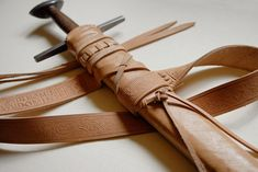 Leatherwork on late 12th century sword scabbard. Free interpretation after finds. medievalandmore