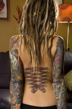 I love her sleeves, corset tattoo, and her dreads!  Beautiful!