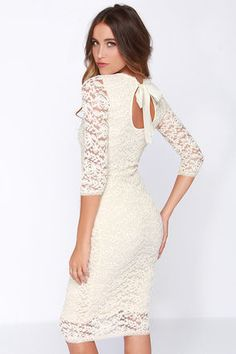 Style and grace are second nature to a gal like you, and the Black Swan Tinsel Cream Lace Midi Dress is ready to showcase your expertise! A beautifully ornate cream floral lace covers this midi dress from the rounded neckline and three quarter sleeves, to the bottom of the bodycon midi-length skirt. As an added feature, the neckline has a round back cutout, topped with a lovely woven ribbon. Hems are trimmed in a charming scalloped lace. Dress is lined, sleeves are sheer Self: 90% Polyester…