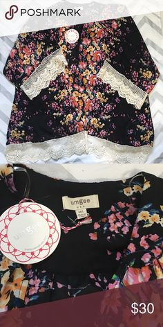 Umgee floral kimono Brand new with tags. Umgee black and floral kimono. Size m/l. Has crochet detail at bottom and around 3/4 sleeves. True to size with room to spare. Umgee Tops Blouses
