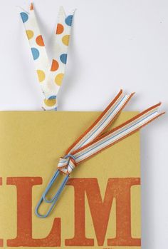 paper clip (thinking instead of ribbon, nubby yarn or other handspun yarn would make a great bookmark)