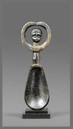 Africa | Anthropomorphic ceremonial spoon ('wakemia') from the Dan people of the Ivory Coast | Wood; brown patina | ca. 1976 or earlier