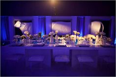 Blue uplighting/wedding reception room with all-white flowers Blue Wedding Receptions, Uplighting Wedding, Wedding Reception Lighting, Wedding Reception Centerpieces, Reception Ideas, Blue White Weddings, White Wedding Flowers, White Flowers, Diy Wedding