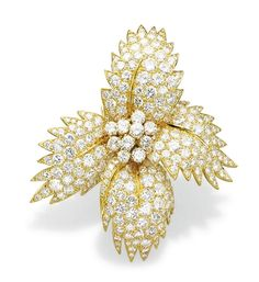 A DIAMOND AND GOLD BROOCH, BY VAN CLEEF & ARPELS   Designed as a stylised bombé flowerhead, pavé-set with brilliant-cut diamonds, to the diamond cluster pistil, 1960s, 6.1 cm long, with French assay mark for gold, in a Van Cleef & Arpels blue suede pouch  Signed Van Cleef & Arpels, no. 19.058