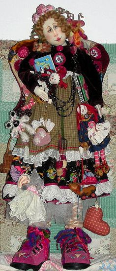 Isn't she wonderful.  love her boards.  did you say you had made one of her dolls?.....Cloth doll