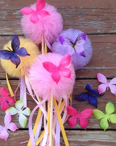 5 Tulle pom poms butterfly  Wand ,Party Decoration,fairy wands,Princess Wands,Butterfly pom pom wands Centerpiece by TullePomPoms on Etsy https://www.etsy.com/listing/191735582/5-tulle-pom-poms-butterfly-wand-party