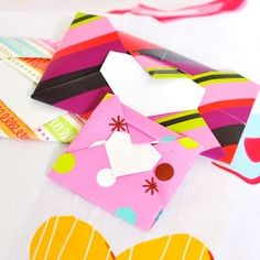 Learn how to fold this heart origami envelope.